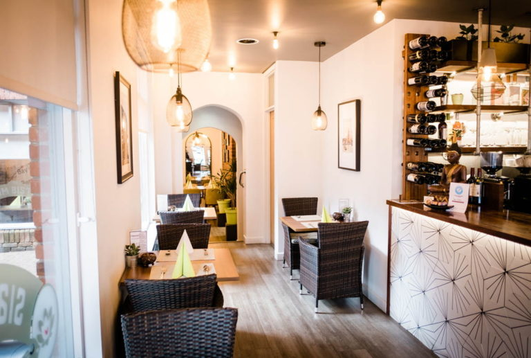 interior of the siam bistro showing wine rack and cozy dinner tables