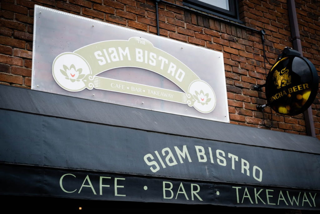 the siam bistro restaurant shop awning canopy with singha beer sign